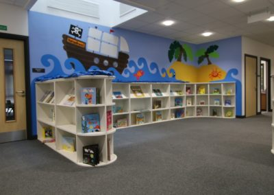 Library with boat cartoon on wall